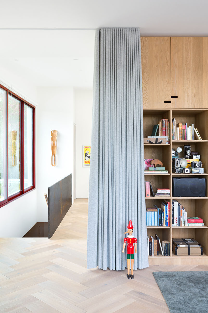 In this modern house, the light wood floor has been arranged in a herringbone pattern.