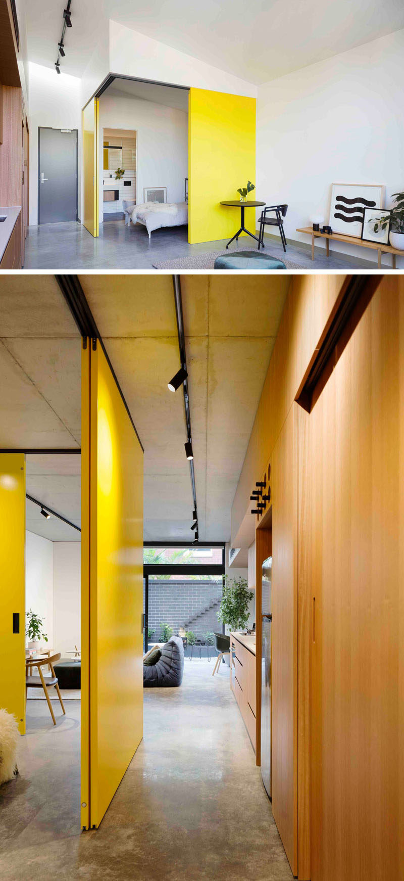 This modern apartment has bright yellow doors that slide open to reveal the bedroom, and the living room opens up to a private courtyard.