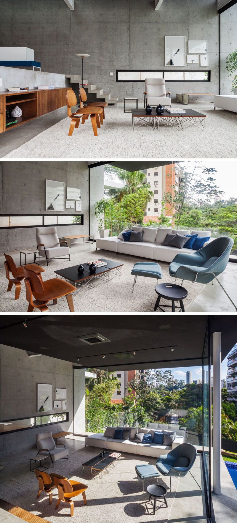 Stepping down to the living area of this modern house, you can see how the large windows flood the entire space with plenty of natural light, which helps to brighten the unfinished concrete walls, while a large rug makes the room feel warmer and assists in anchoring the furniture in the large room.