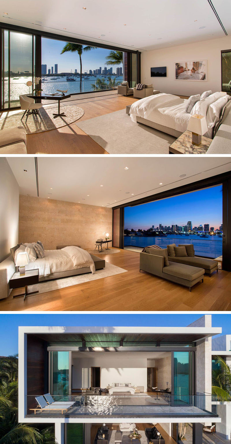 This large and modern master bedroom has a small sitting area and work area that opens up to a private balcony.