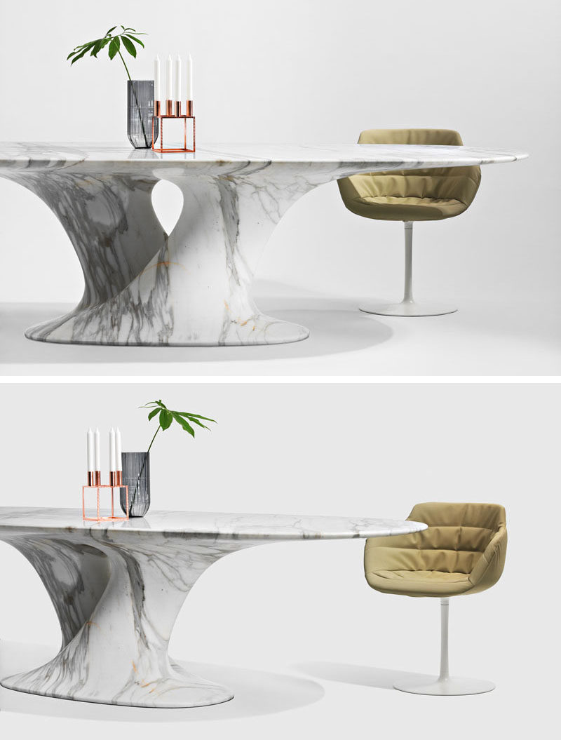 Austrian designer Rainer Mutsch has created a collection of contemporary furniture made entirely out of marble, that includes a sculptural dining table.