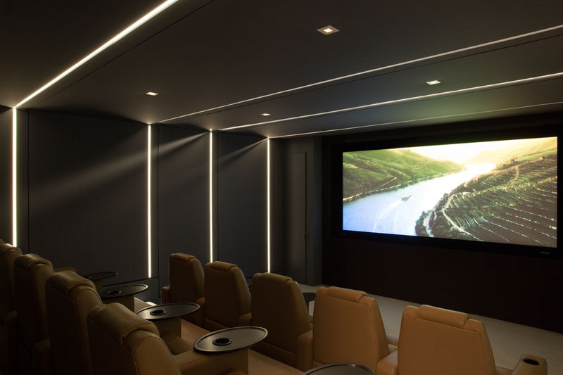 This modern home cinema has tiered seating, perfect for watching movies with friends and family.
