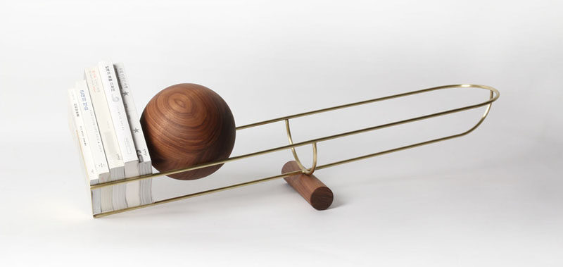 This Bookshelf Design Uses A Wood Ball To Keep Books In Place