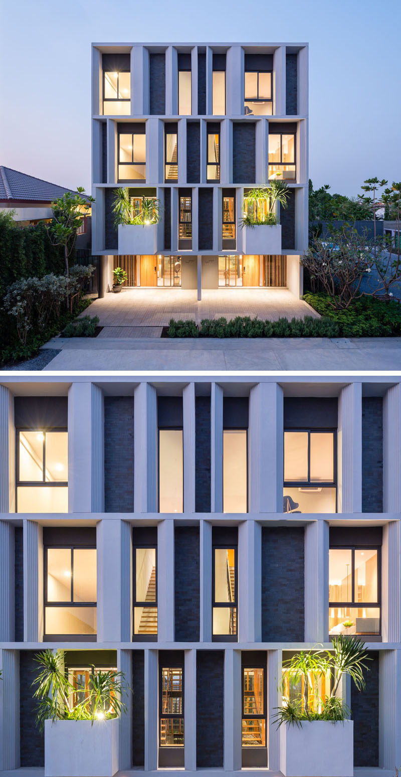 The facade of these townhouses welcomes visitors with for Modern townhouse architecture