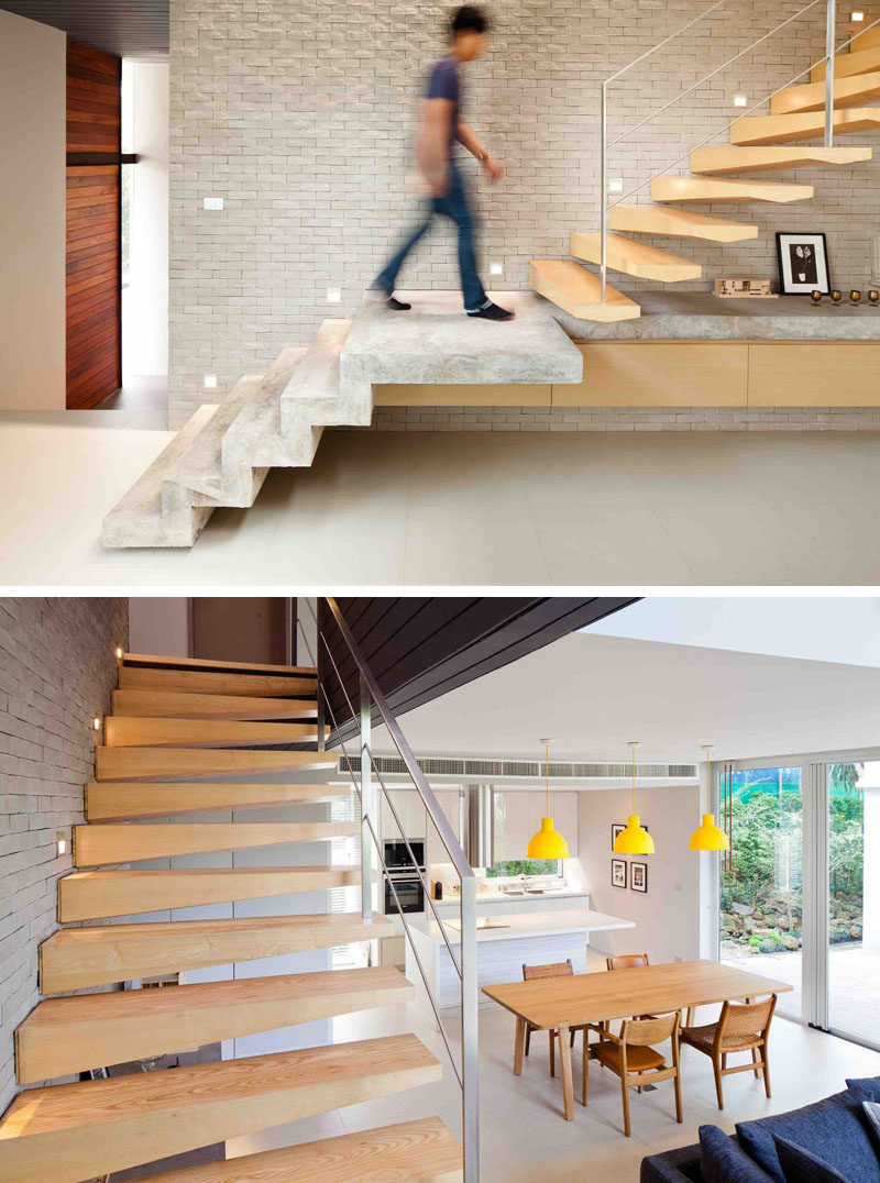 These modern concrete and wood stairs lead to the second floor of this modern house. The concrete steps continue on to create a display space for a floating cabinet, while the the wood stairs are slightly sculptural in their design. When heading upstairs, you are also able to look down on the dining area and kitchen.
