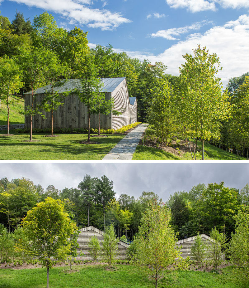 This modern house, which is split into two asymmetric gable roof forms, is clad in a siding composed of re-purposed snow fencing, so that it already has the natural beauty of the weathered boards.