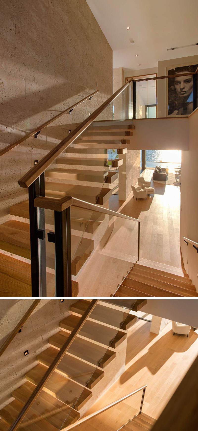 Light wood stairs with glass railings lead to the upper floor of this modern home.