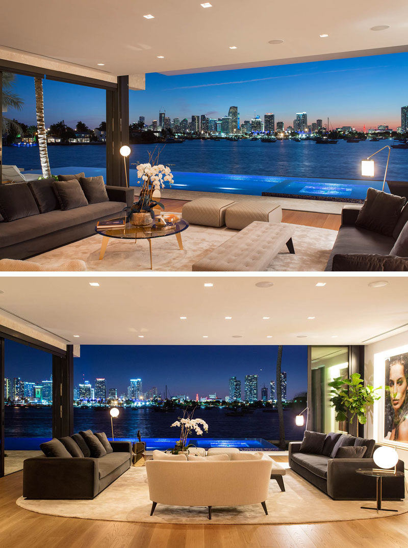 In this modern living room, the sliding glass doors can be opened completely, so that the living room has an uninterrupted view of downtown Miami.