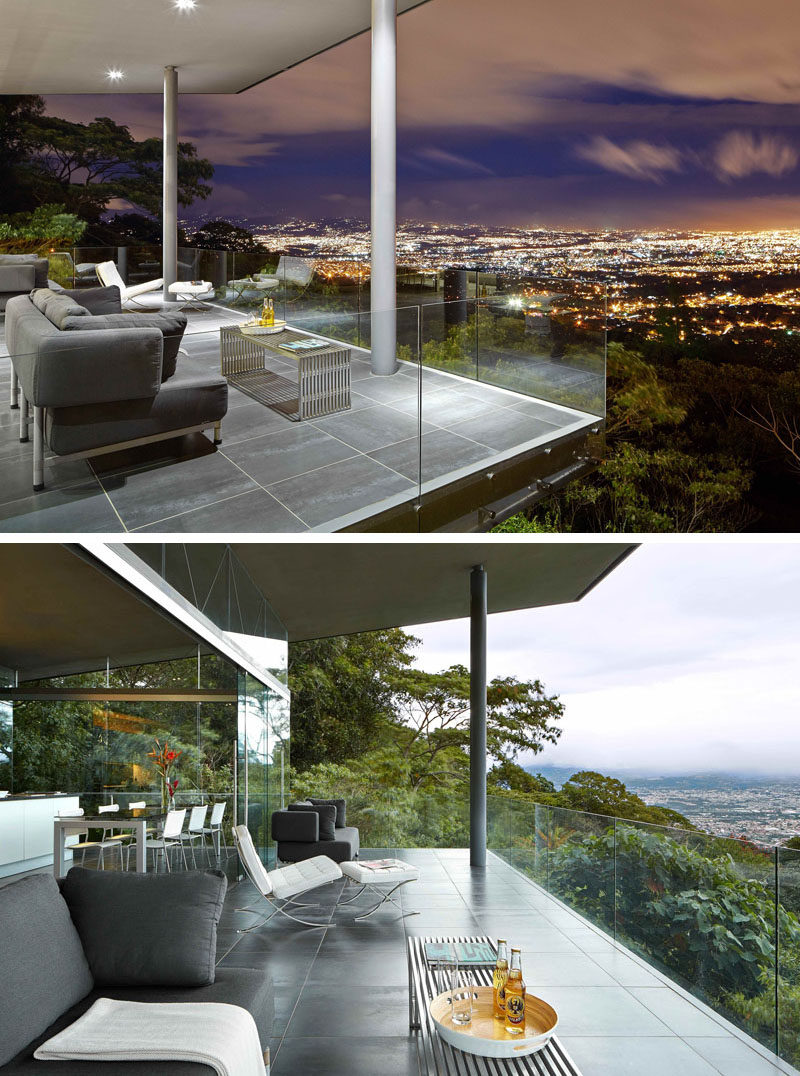 This architecturally designed entertaining room has a covered outdoor space with a couple of seating options. Glass safety railings provide an unobstructed view of the city below.