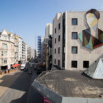 A Large Recycled Wood Mural Was Installed On The Side Of This Building In Belgium
