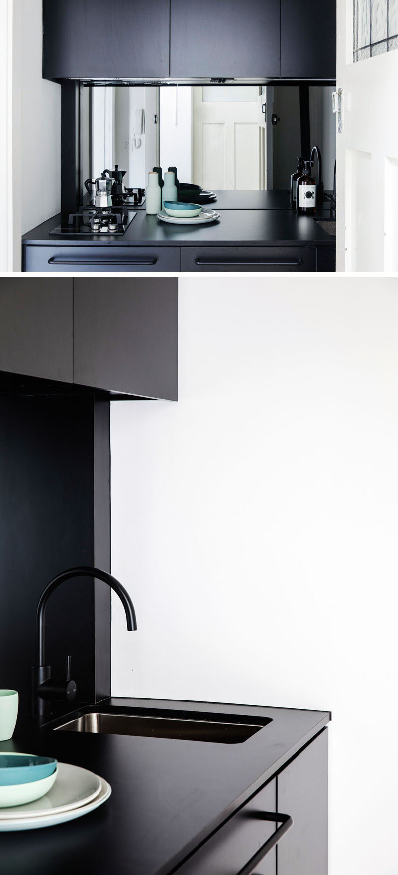 Stepping inside this tiny apartment, you walk straight into a small kitchen. The matte black cabinets stand out, and a mirrored backsplash helps to make the space appear larger.
