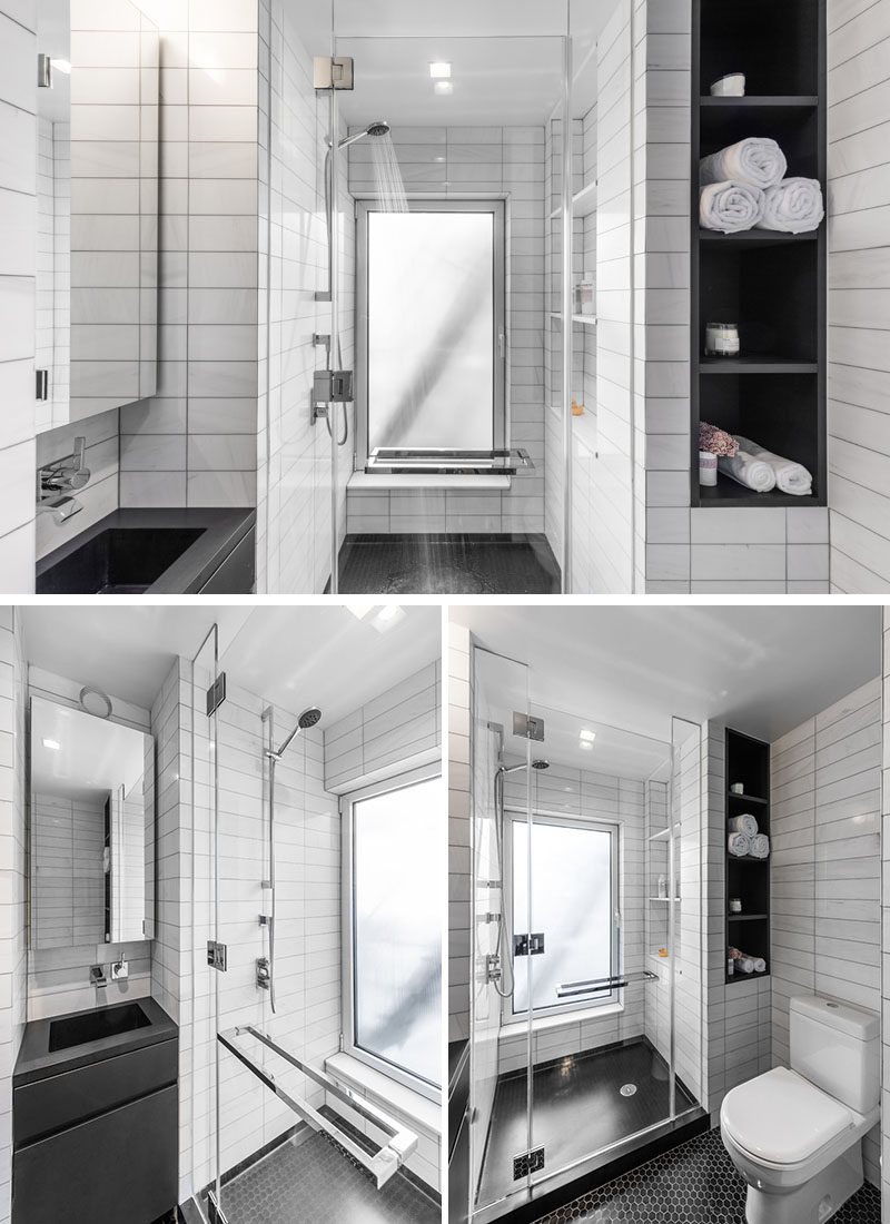 This small bathroom has a walk-in glass enclosed shower, and a small vanity area. White tiles have been used to keep the bathroom feeling spacious, and black open shelving adds some additional storage to the small space.