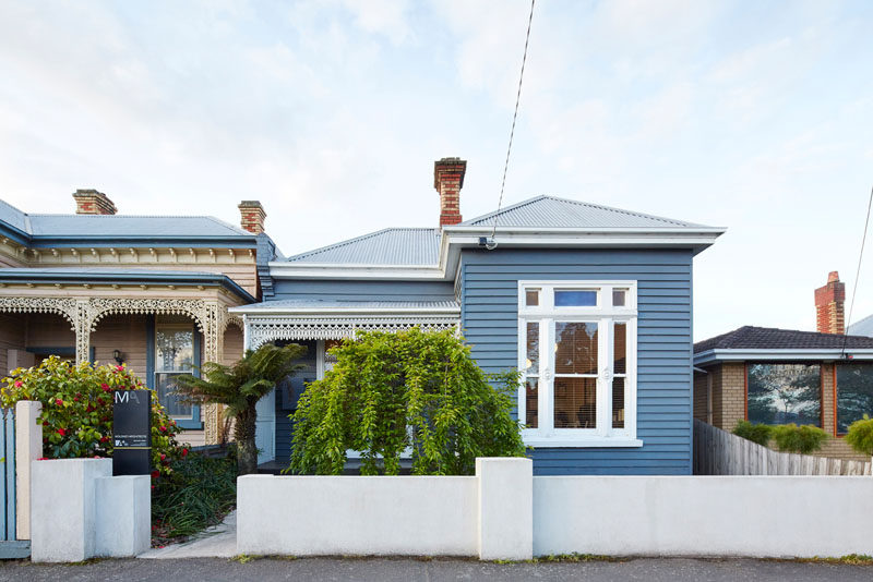 This turn-of-the-century weatherboard home in Australia, has a contemporary wooden house extension, that is hidden from view from the street.