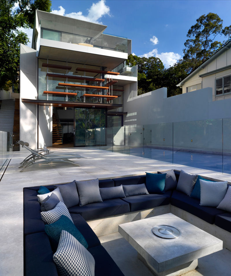This modern house with multiple levels, has a swimming pool, outdoor deck, and a sunken lounge.