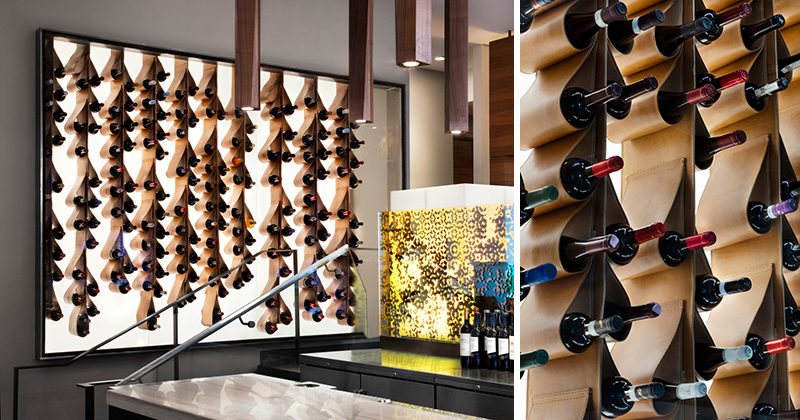 This renovated restaurant in Toronto, features a unique custom designed wine display made from leather that cradles the bottles of wine. It is also back lit and framed behind a glass wall, making it more like a piece of artwork than a storage solution.