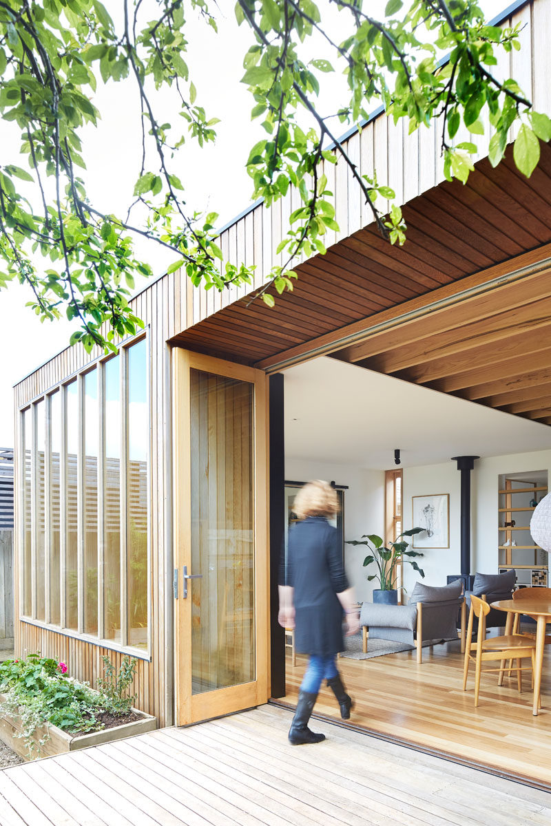 This modern 'Wooden Box' house extension uses Tasmanian Oak for the windows and exposed beams, Cedar for the siding, and Blackbutt for the wood flooring.