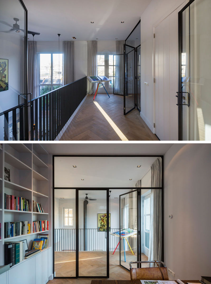 This modern house has a home office that can be entered through a set of glass double doors, which allow for as much light to enter the room as possible. White built-in bookshelves and storage keep the room organized.