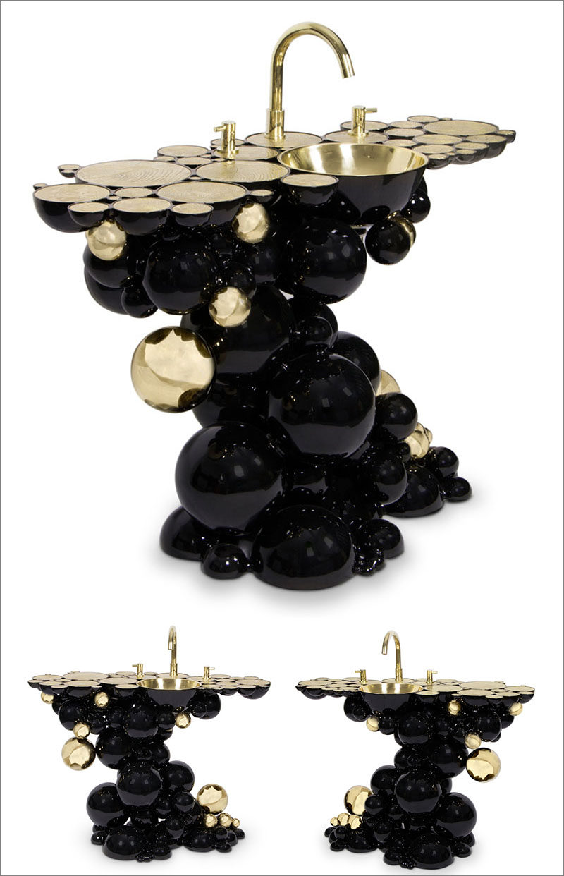 Designer Joaquim Paulo has designed the Newton Collection for Maison Valentina, that includes a bathtub and washbasins that have a black bubbly exterior and a rich gold interior.