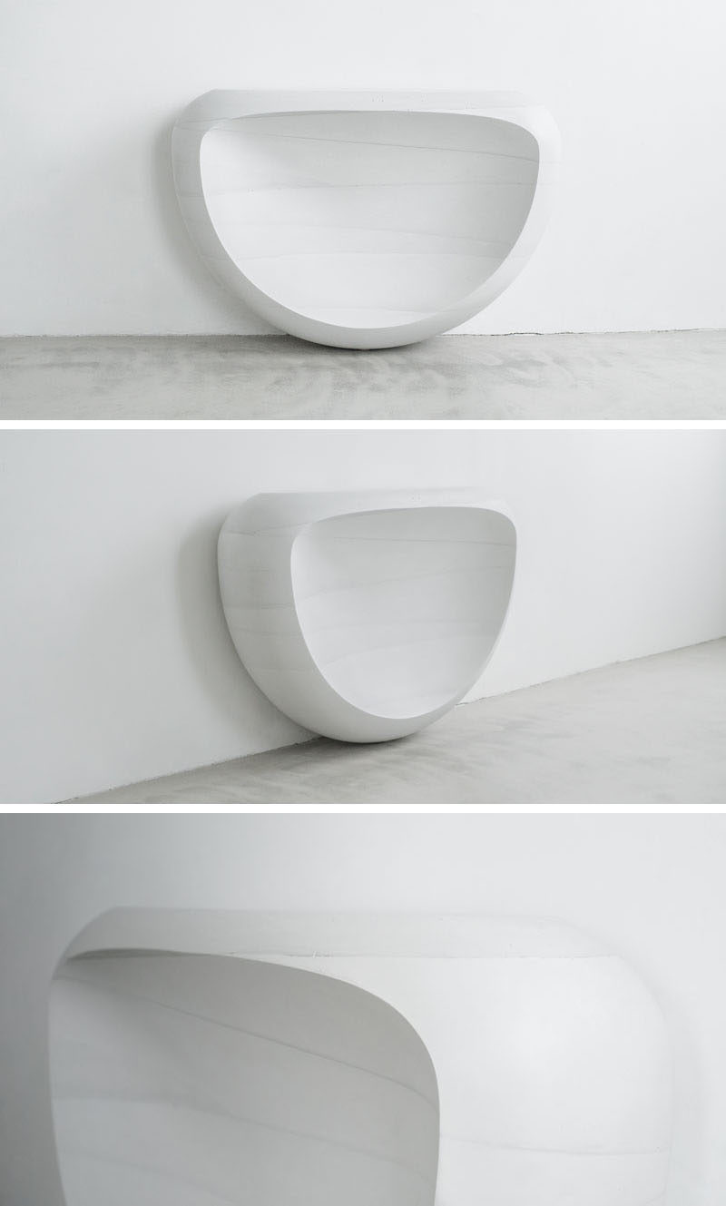 Designer Fernando Mastrangelo has created a carved concrete furniture collection named Ghost, that consists of dining table, coffee table and console.