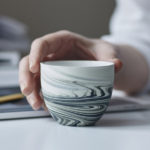 A Collection Of Espresso Cups Designed With Unique Decorative Swirls