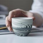 A Collection Of Espresso Cups Designed With Unique Decorative Swirls
