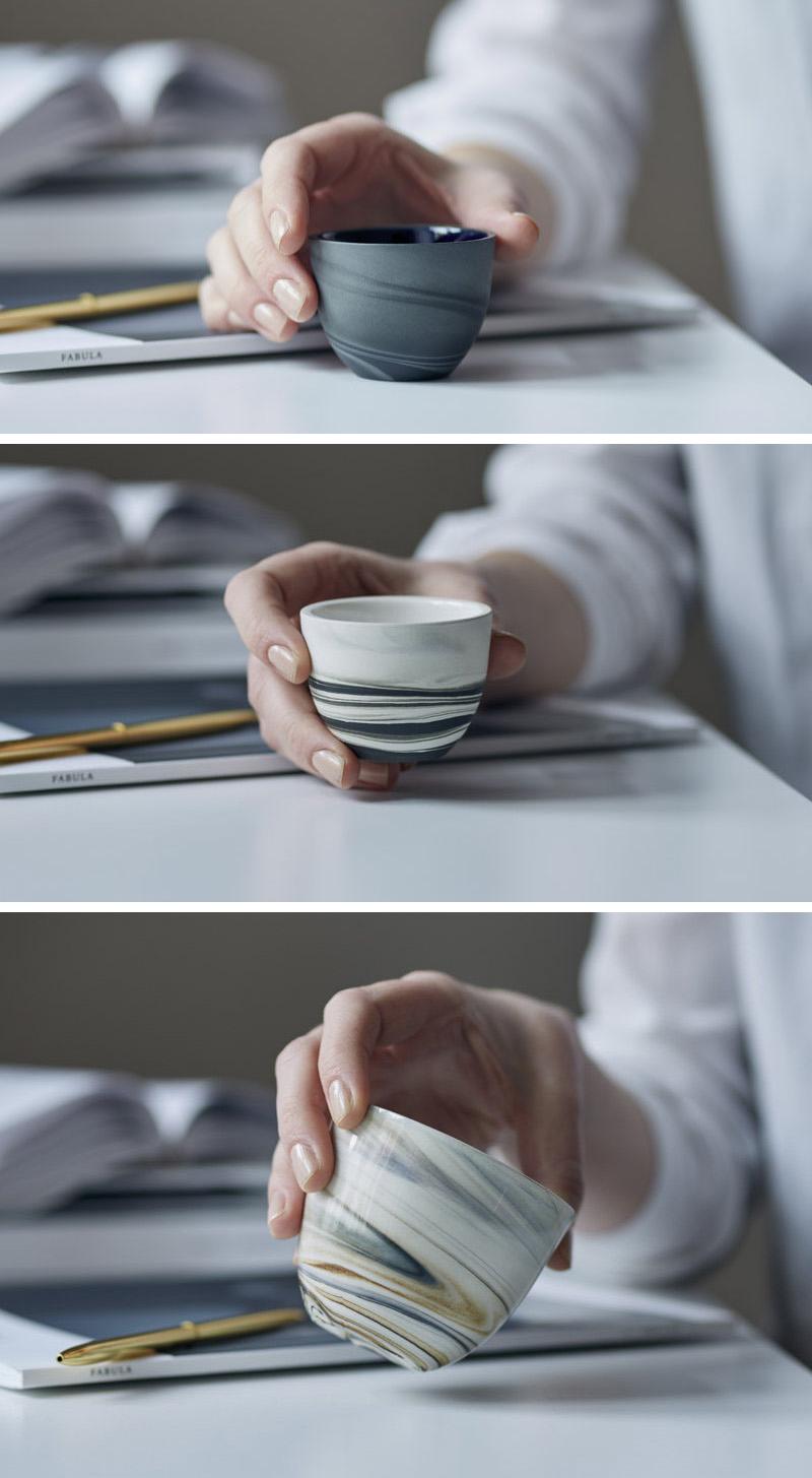 These modern glossy espresso cups are white grey black and cream colored.