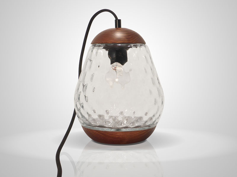 Mariana Costa e Silva has designed the Jar Lamp, a simple glass and wood table lamp, that brings a modern twist to vintage style lighting.