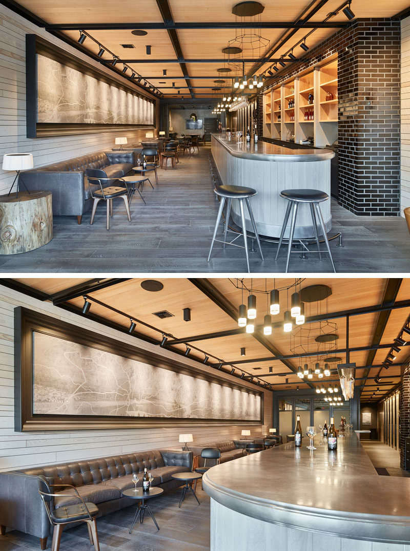 Entering the tasting room, a forty foot custom made art piece hangs above the seating, opposite of the bar. The casual seating and the neutral tones of the ceiling, walls, and flooring contrast with the dark furniture and light fixtures to create a contemporary look.