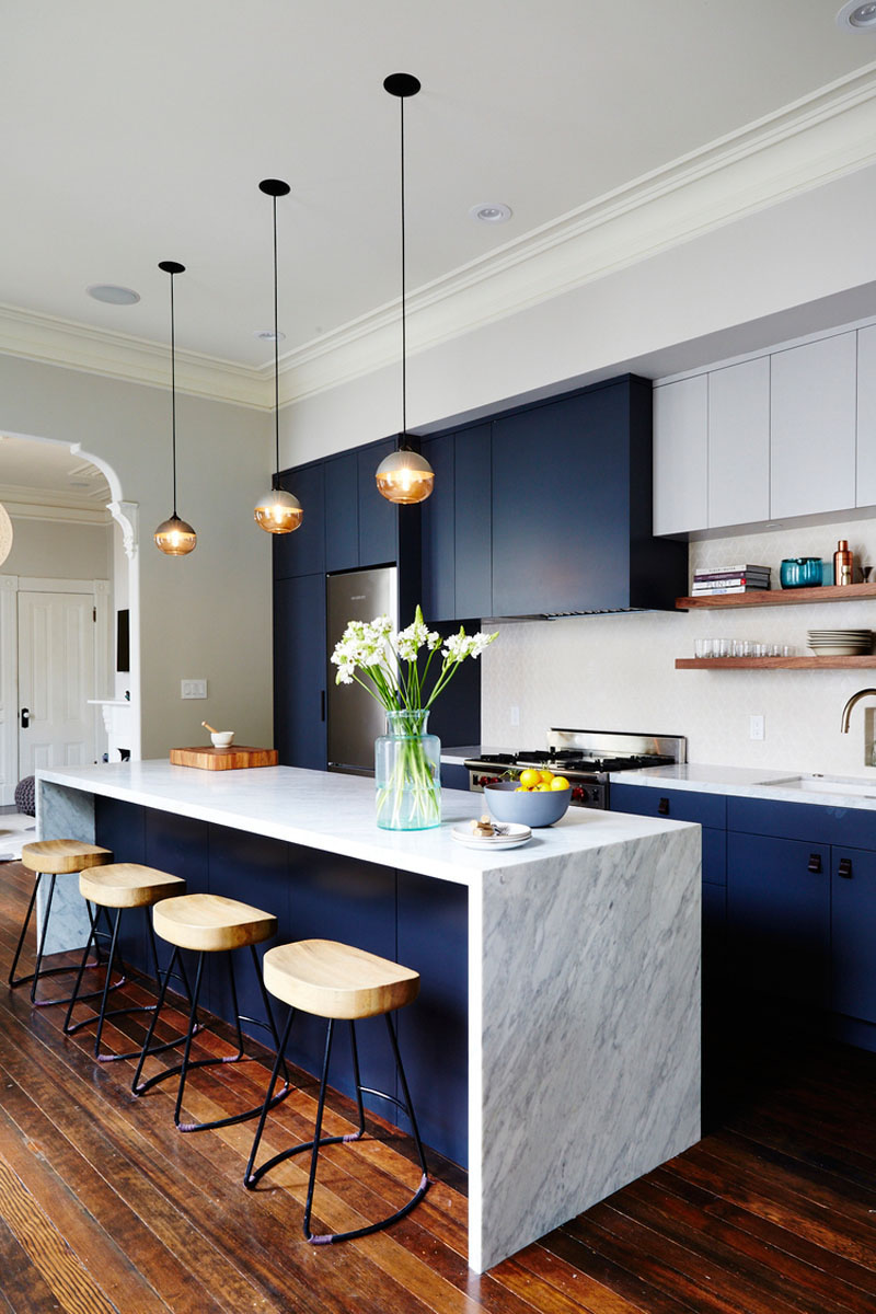 The Dark Blue Cabinets Of This Modern Kitchen Bring In A Touch Sophisticated Fun And Help Out Darker Flecks Marble Island