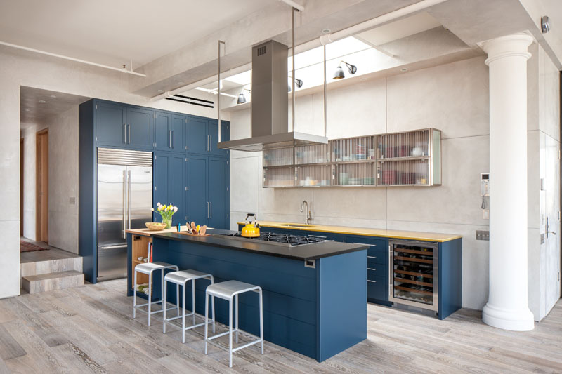 The Rich Blue Kitchen Cabinets And Stainless Steel Hardware With Yellow Accent Details Make This Feel Sophisticated Yet Playful