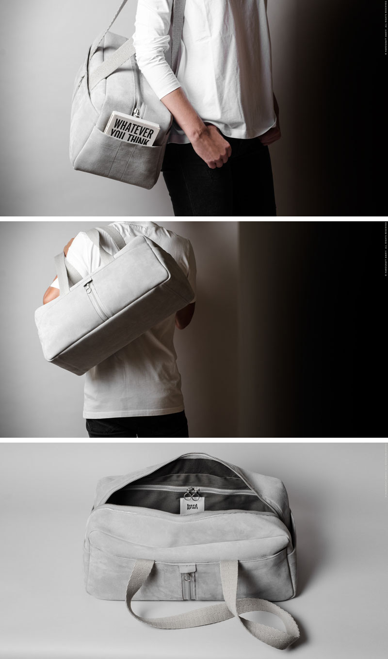 This modern duffel bag has long canvas straps and is light grey, it's easy to swing over your shoulder as you head out on the road.