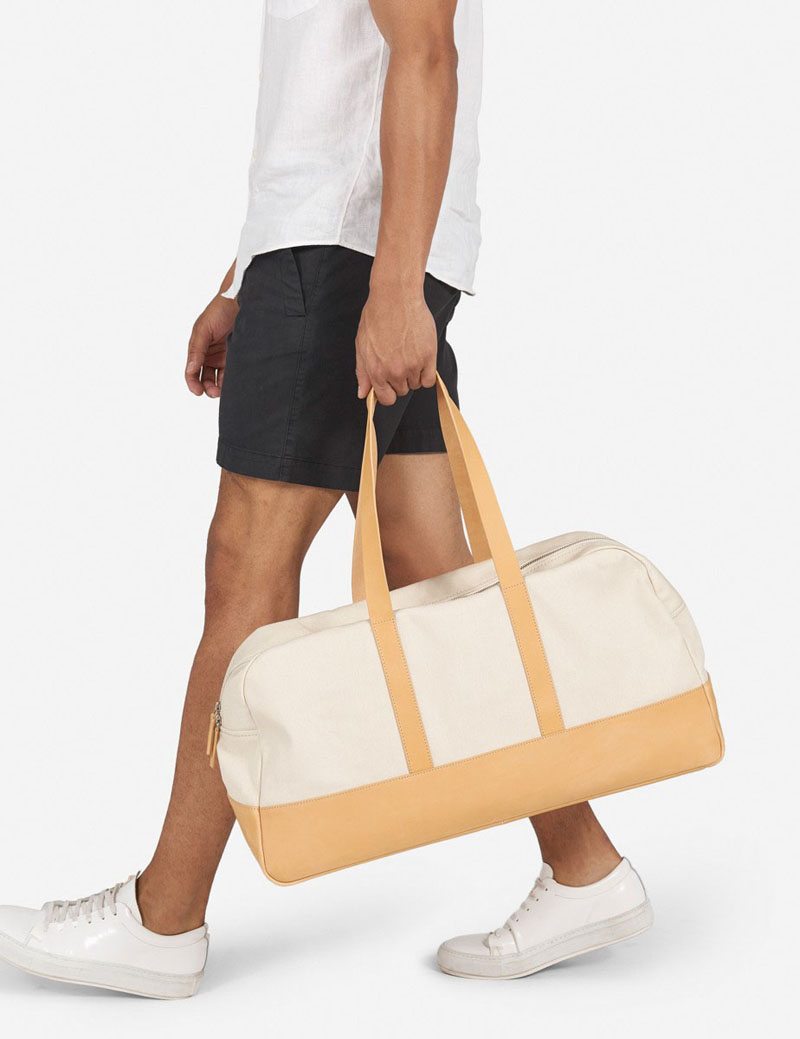 This modern leather duffel bag is light in color and perfect for the spring and summer seasons