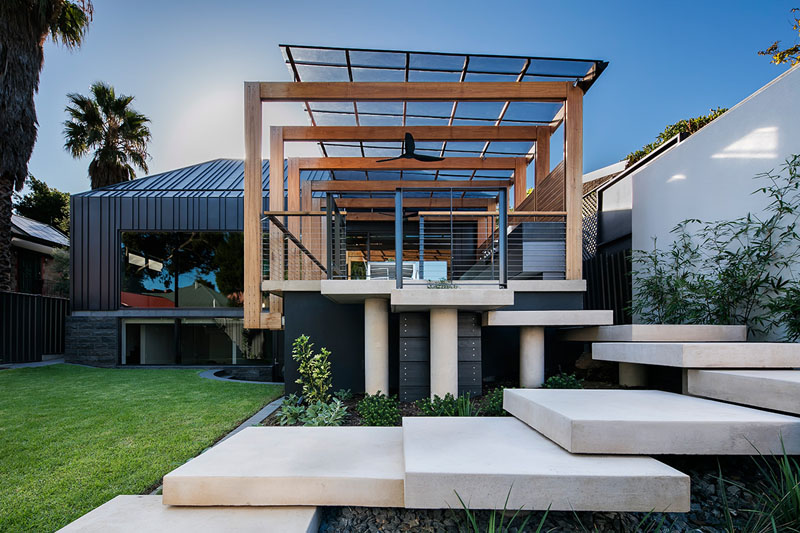 Architecture firm Glasshouse designed a family friendly backyard space with  a number of design details like - This House Extension Has A Modern Pergola That Leads To A Swimming