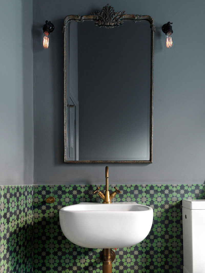 In this bathroom, bronze accents and grey walls have been paired with colorful patterned Encaustic tiles from Europe.