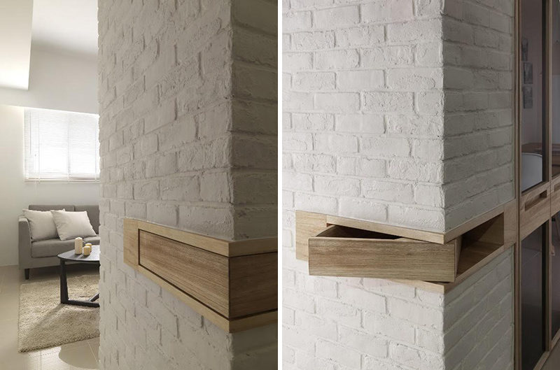 This white painted brick wall has a small wood section that wraps around the corner of the wall. This wood section can actually be pushed out and becomes a secret hiding space.