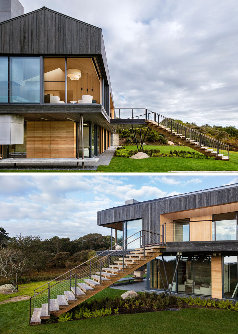 This modern house, which sits on 4.25 acres, overlooks the sea and is surrounded by farmland. The upper floor of the home has direct access to the landscaped yard via angled stairs.