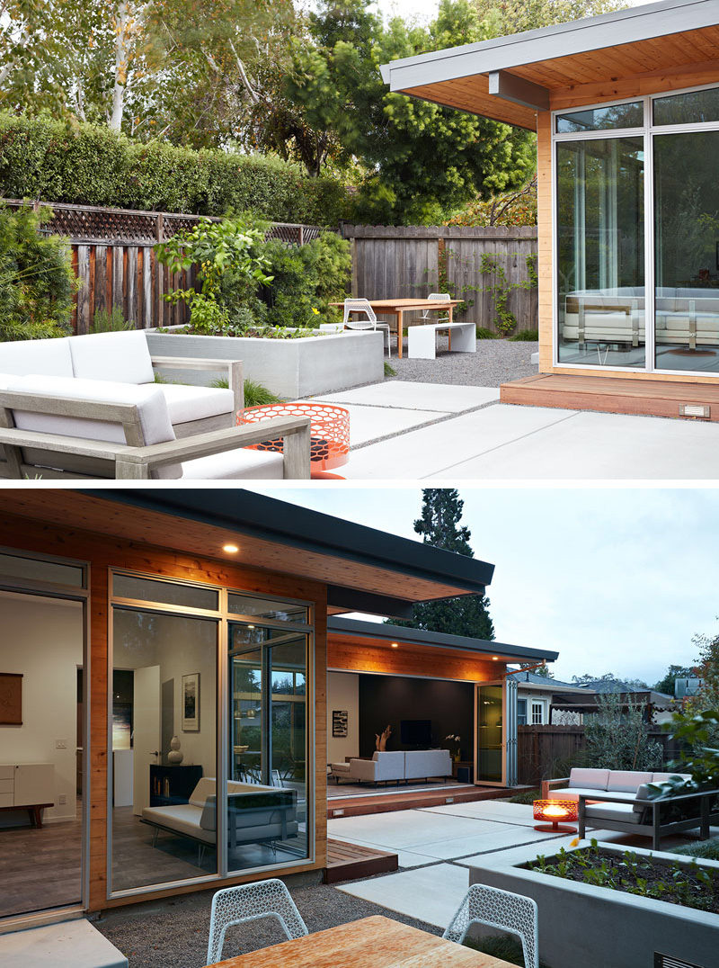 Tucked beside the entertaining patio is an outdoor dining area set up with a wood dining table and bench seating.