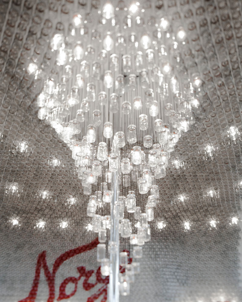 This large, modern and delicate chandelier in an airport bar in Oslo, is made from glass jars.