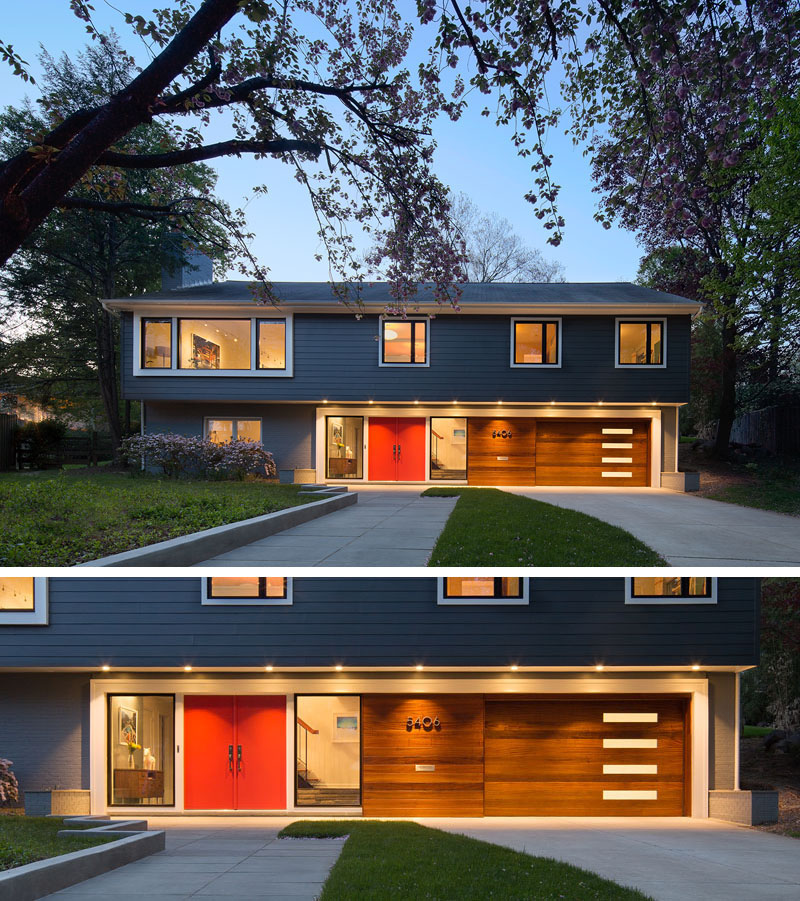 Between two floor-to-ceiling windows, the large bright red double door stands out amongst the exterior of this modern home.