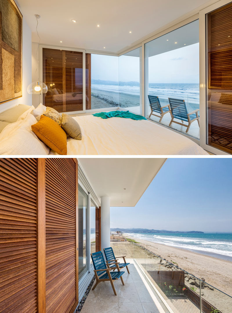 Simplistic lighting and a corner window keep the bedroom bright, and allow for the view of the beach to be the most important element in the room.