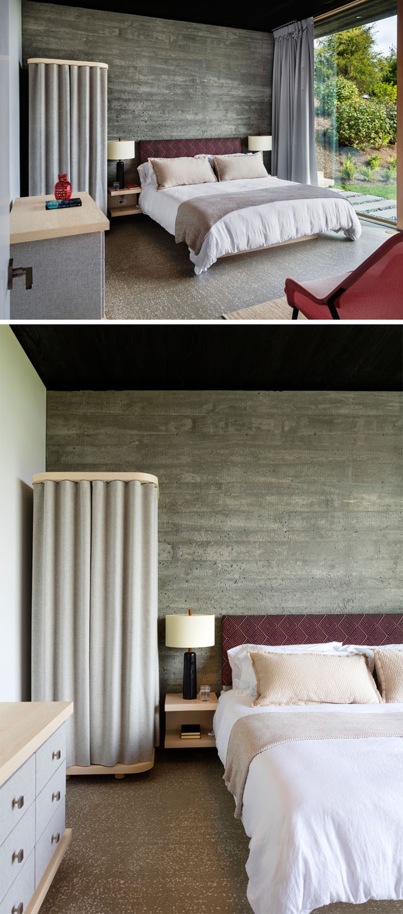 This modern bedroom has kept the concrete wall in its natural state, and it's softened by the use of grey curtains. Pops of deep red add a touch of color to the bedroom.
