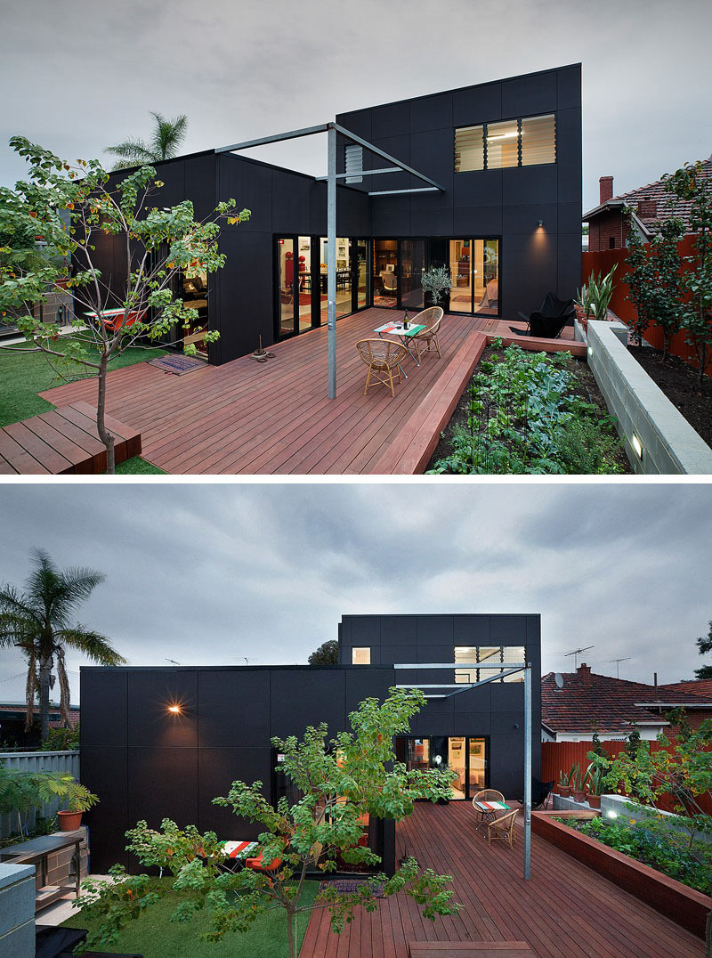 The two storey extension on this modern home is covered in black siding to give it a contemporary look.