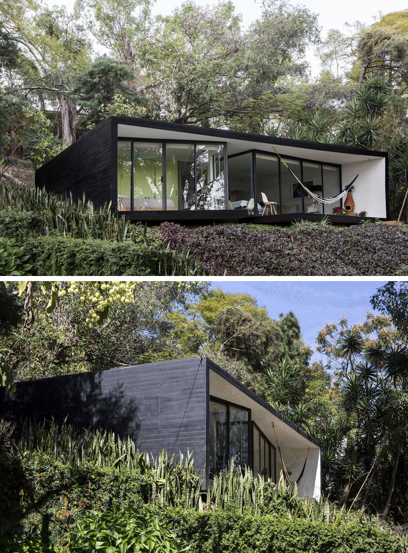 This small house has been covered in black siding to give it a modern feel and conceal it in the dark forest around it.