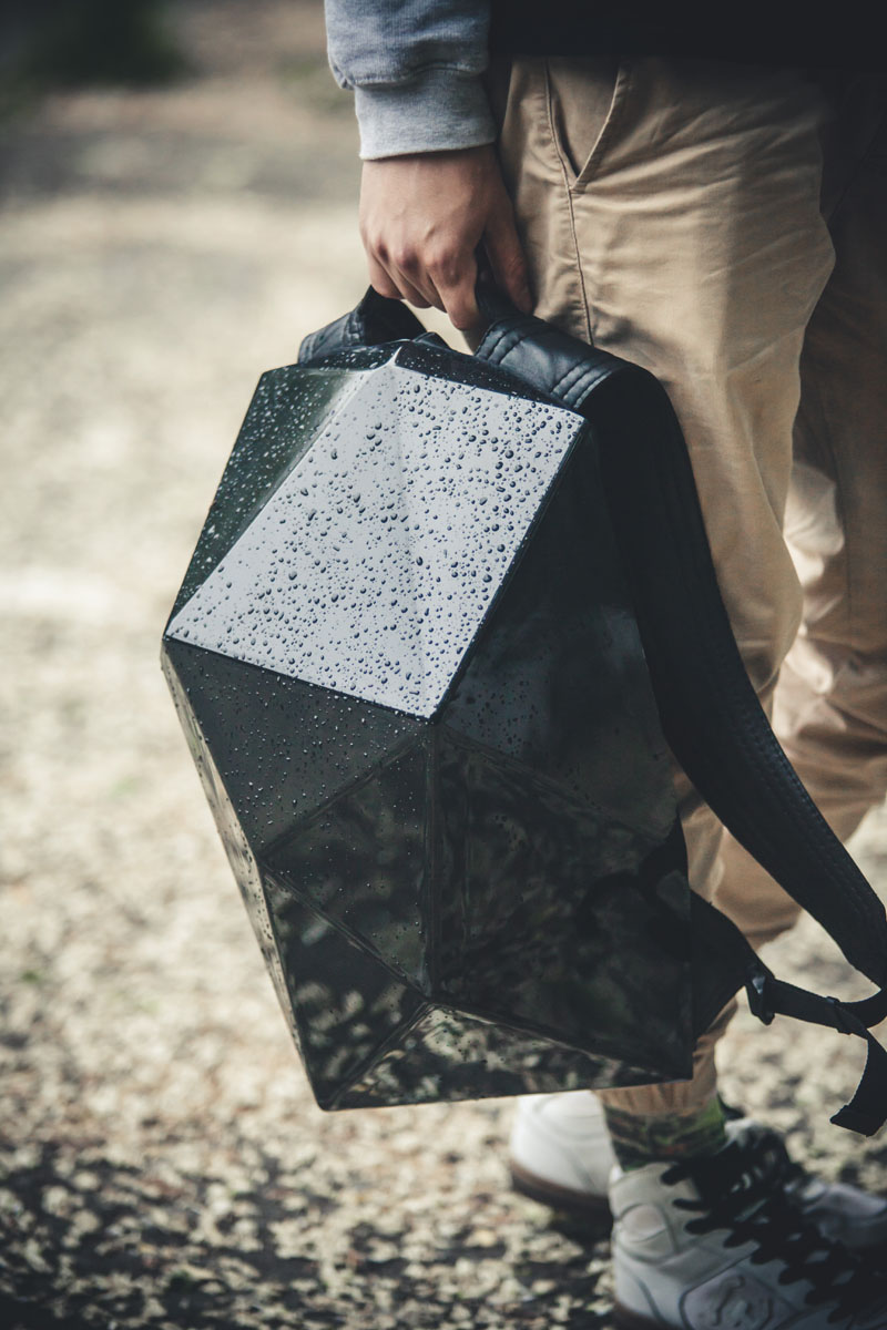 When the hard shell is on this modern backpack, the glossy polystyrene material keeps the bag protected from the rain and other damage.