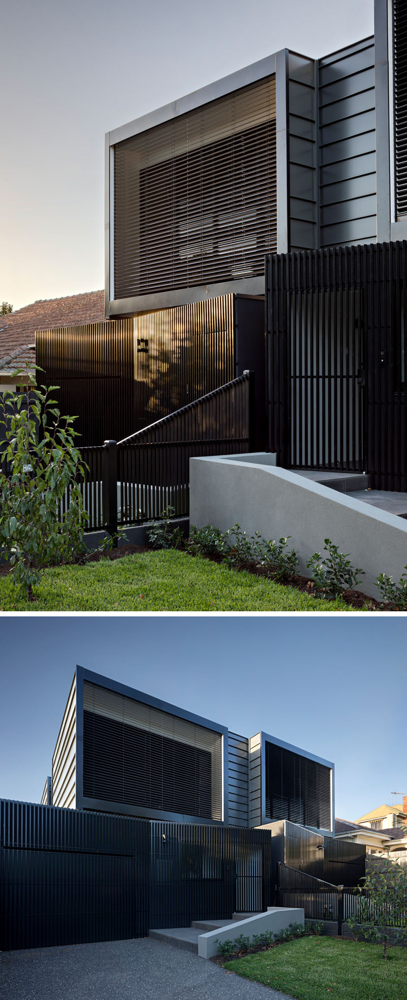 The exterior of the black modern townhouses have lightweight aluminium batten screening, and metal cladding.