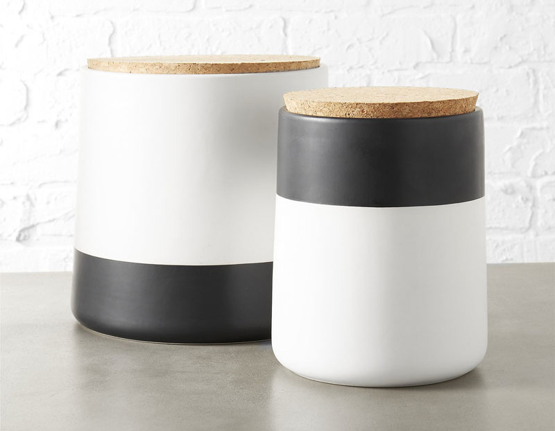 Bold in black and white, these modern dipped stoneware canisters are smooth with a matte finish, and can spice up any decor instantaneously.