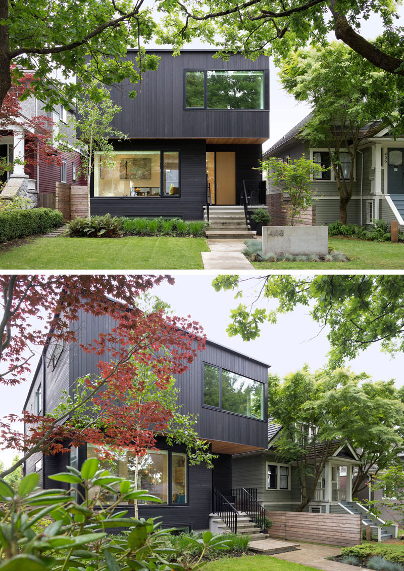 Black wood siding covers the exterior of this suburban modern family home.