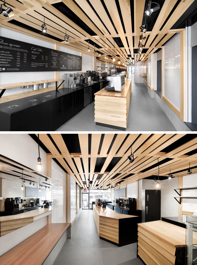 NatureHumaine designed Au Pain Doré, a modern cafe and bakery in Montreal, Quebec, featuring black cabinetry and light wood slats that pay tribute to the lattice of traditional wood bread baskets