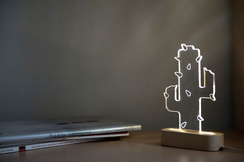 This modern small concrete and acrylic cactus lamp is a low maintenance alternative to a real plant and has the added benefit of providing a unique light source.