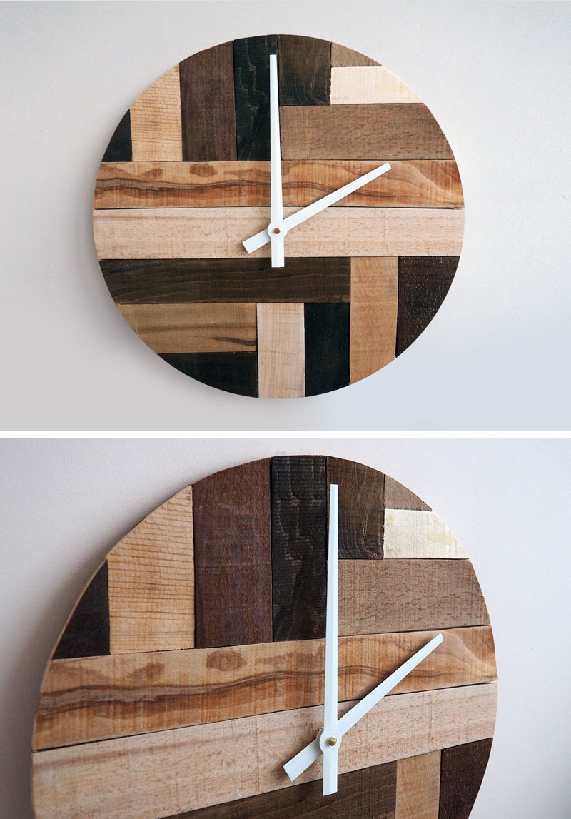 Strips of reclaimed wood with different finishes have been used to create this wood clock that's both modern and rustic looking. #ModernWoodClock #WallClock #ModernDecor #ModernClock